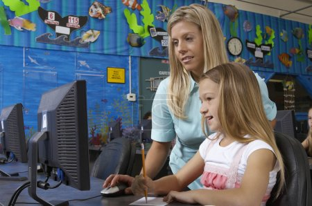 Teacher And Student Using Computer