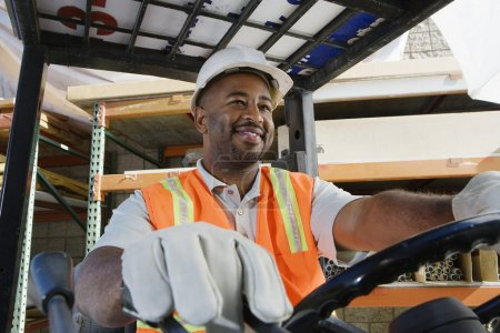 Industrial Worker Driving Forklift At Workplace