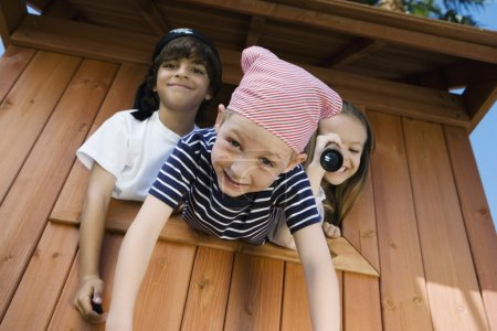 Kids Playing In Playhouse