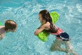 Happy children  in swimming pool