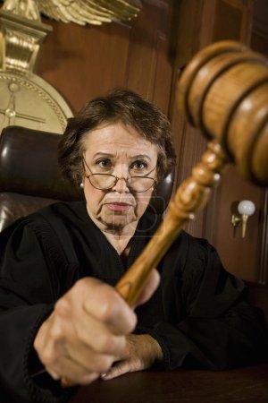 Female Judge Knocking Gavel