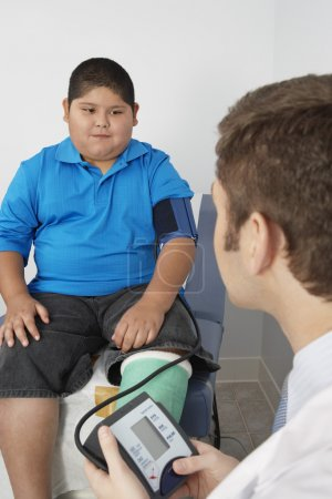 Boy Having His Blood Pressure Checked