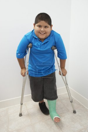 Boy Standing With Crutches