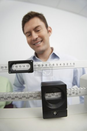Man Looking At Weight Scale