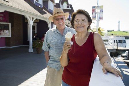 Senior Couple With Woman Holding Ice-Cream