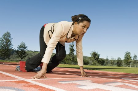 Businesswoman At Starting Blocks