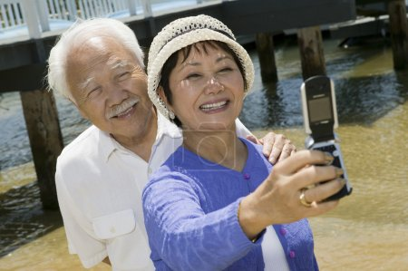 Senior couple photographing themselves