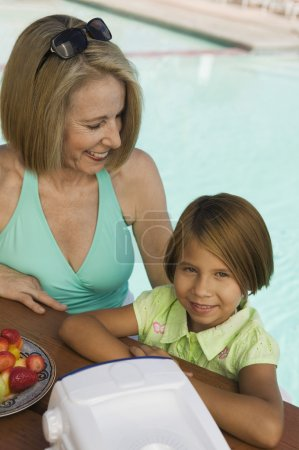 Girl with grandmother at pool