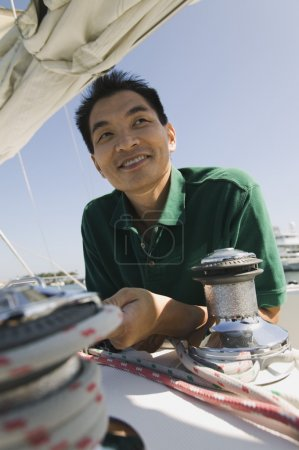 Asian Man on sailboat