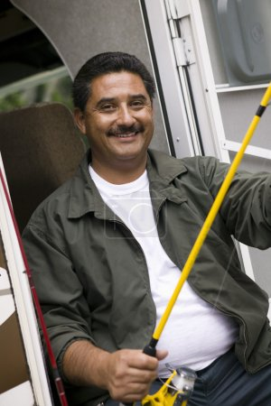 Middle-aged man holding fishing rod