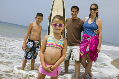 Little Girl with Her Family on Beach