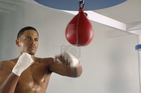 Boxer hitting punching speed bag