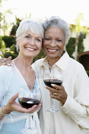Friends outside with wine glasses