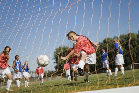 Teenager Kicking Goal