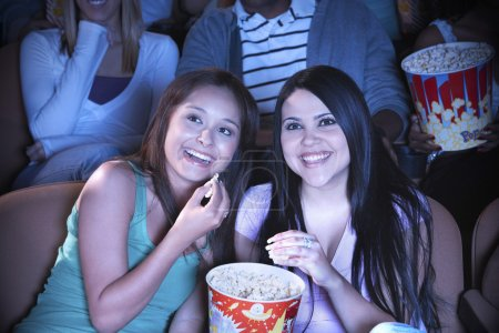 Friends eating popcorn