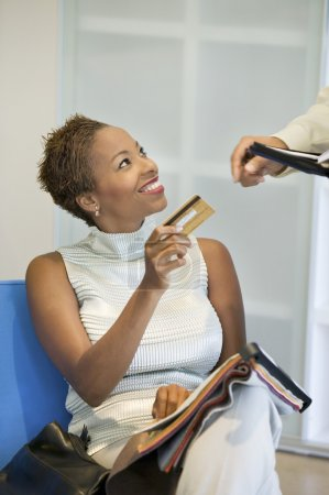 Woman giving partner Credit Card