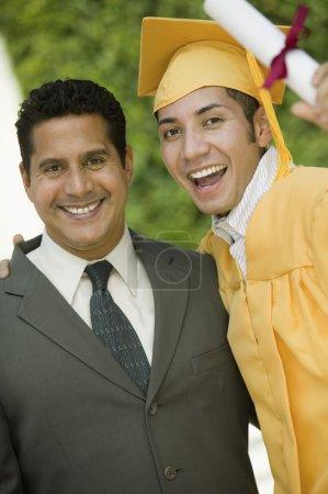 Graduate hoisting diploma