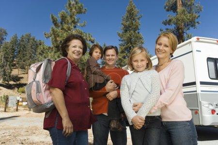 Family standing outside of RV