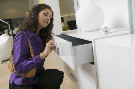 Woman Examining White Dresser