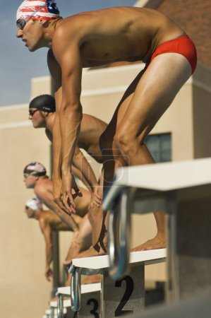 Photo for Swimmers Lined Up at Starting Blocks - Royalty Free Image