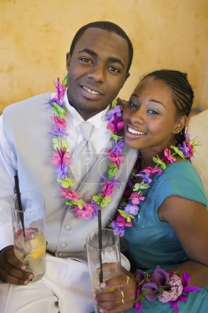 Couple Drinking and Wearing Leis