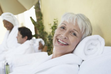 Woman relaxing at spa in bathrobe