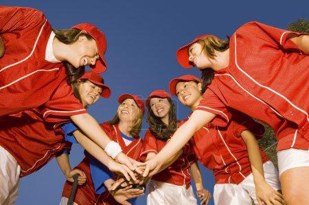 Softball team in huddle