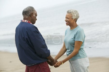 Photo for Senior couple holding hands on beach - Royalty Free Image