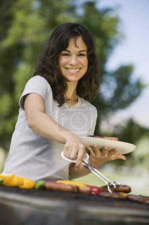 Woman Grilling Food