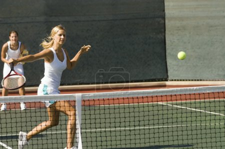 Doubles Player Hitting Backhand