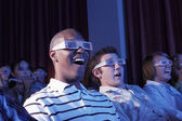 Young men watching a 3-D movie