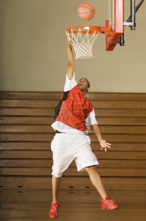 Basketball player missing slam dunk