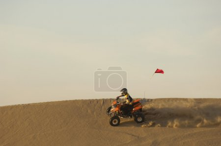 Young man riding ATV