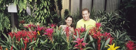 Couple in plant nursery