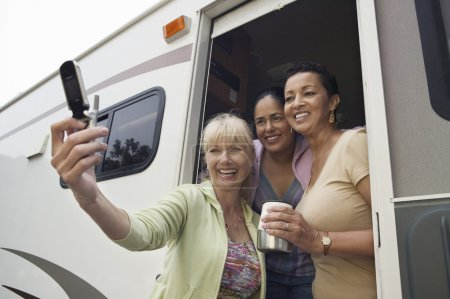 Ladies in RV Using Camera Phone