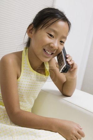 Girl Talking on Cordless Telephone