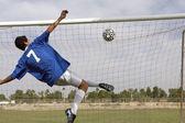 young man scoring goal