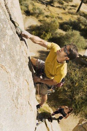 Man Climbing on Cliff