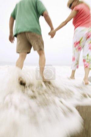 Couple walking in surf