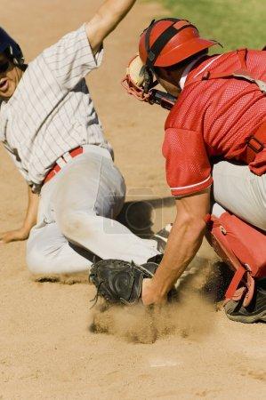 Baseball players at home base