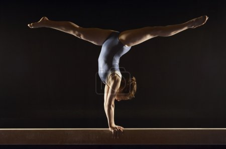 Gymnast doing split handstand
