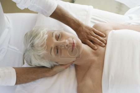 Photo for Closeup of a senior woman receiving massage at spa - Royalty Free Image