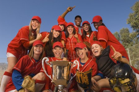 female softball team celebrating