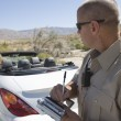 Closeup of a police officer writing traffic ticket...