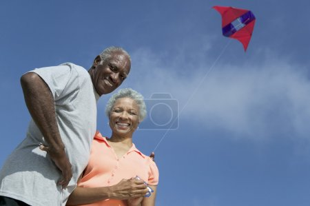 Senior couple flying kite
