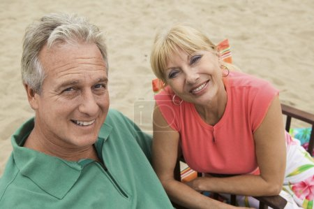 Photo for Mature couple at beach (portrait) - Royalty Free Image