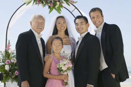 Bride and Groom with best man and family