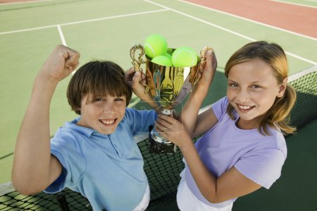 Brother and Sister on tennis court