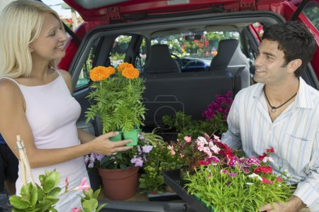 Couple with potted Plants