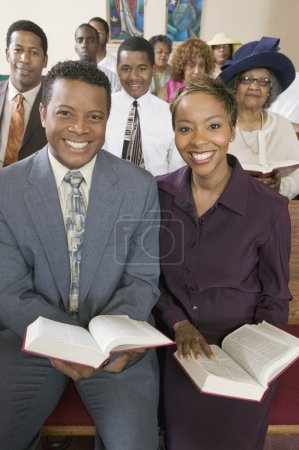 Young couple with Bibles
